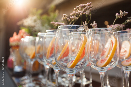 Empty wineglasses with decorating on corporate event