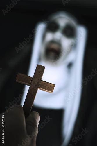 Wallpaper Mural frightening evil nun screaming in front of a cross.