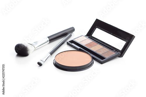 The makeup products. Brush and eyeshadow powder. Fototapeta