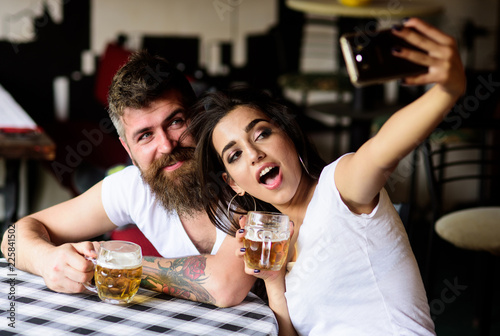 Take selfie photo to remember great date in pub Fototapeta
