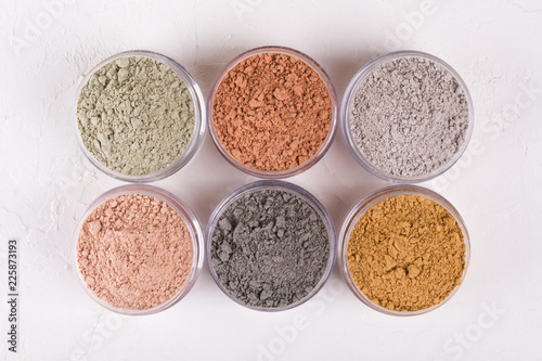 Stampa su Tela Set of different cosmetic clay mud powders on white background