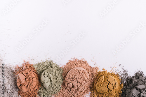 Fotografia Set of different cosmetic clay mud powders on white background