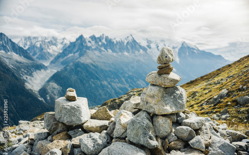 Leinwand Poster Pyramid made by stones in France in the background Mont-Blanc