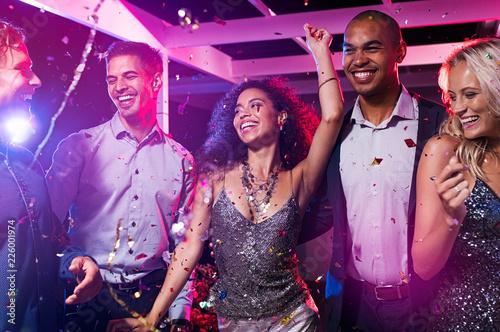 Friends dance at disco club