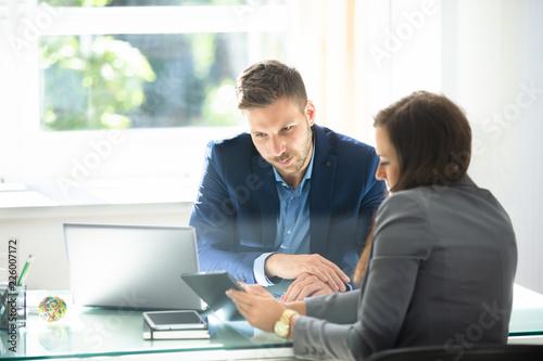 Slika na platnu Two Businesspeople Using Digital Tablet