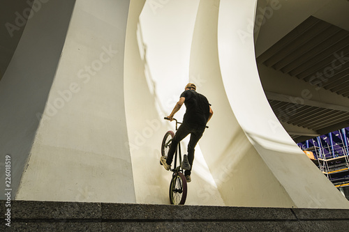 Guy riding a bmx bike on the street. Freestyle BMX in the city