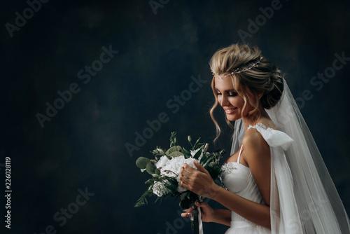 Murais de parede beautiful sexy blonde bride posing in wedding dress with her husband