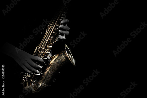 Photo Saxophone player. Saxophonist playing jazz music instrument