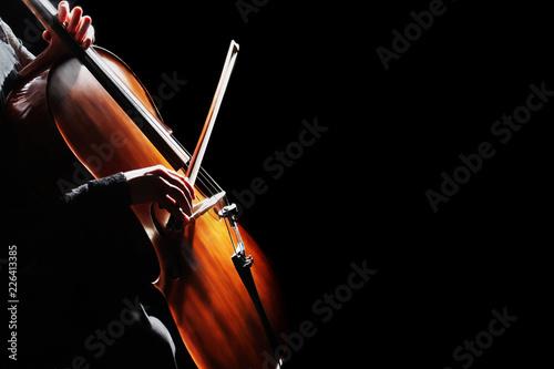 Cello player. Cellist hands playing cello Fototapeta