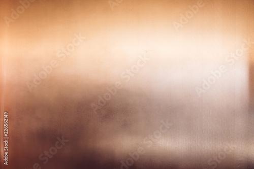 Art deco style shiny glossy copper clad wall with light reflection Fototapeta