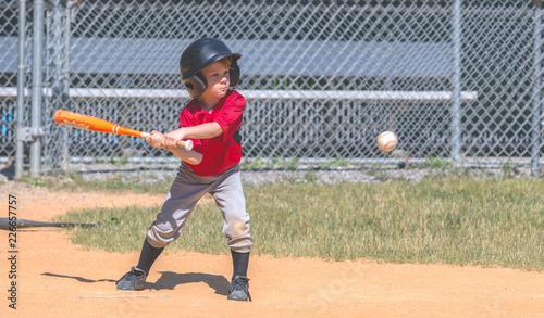 Baseball Player Swinging at Ball