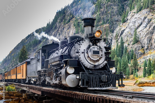 Fotografie, Obraz Vintage Steam Train Crossing a River in Colorado