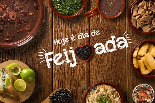 "Brazilian Feijoada Food. Written ""Today is Feijoada's Day"" in Portuguese. Top view"