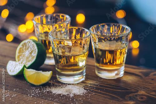 Obraz na płótnie Shot of tequila with lime and salt on bokeh background