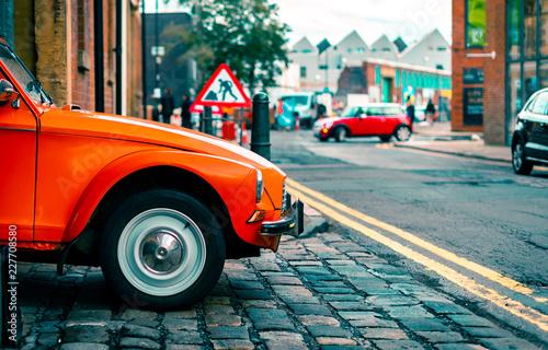 A Citroën Dyane leaves a parking garage driven by an old woman in Sheffield, UK Fototapeta