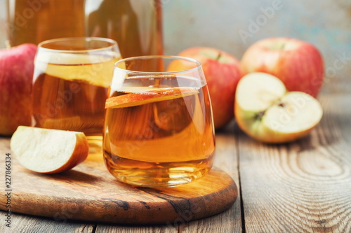 Canvas Print Organic Apple cider or juice on a wooden table