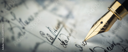 Fountain pen on an vintage handwritten letter. Old history background. Retro style.