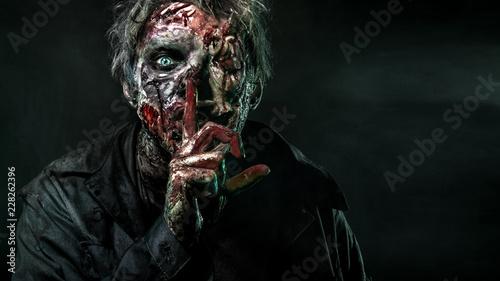 Fotografia Close-up portrait of a horrible scary zombie man