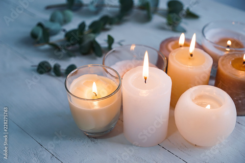 Wallpaper Mural Beautiful burning candles on wooden table