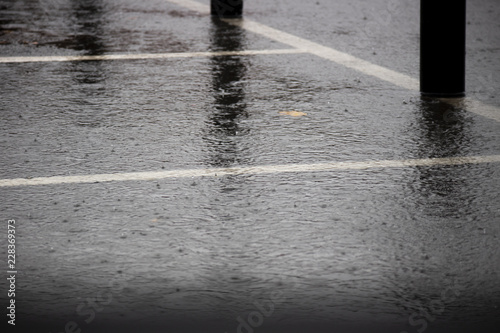 Fotografie, Tablou Heavy rain with localised flooding in supermarket car park