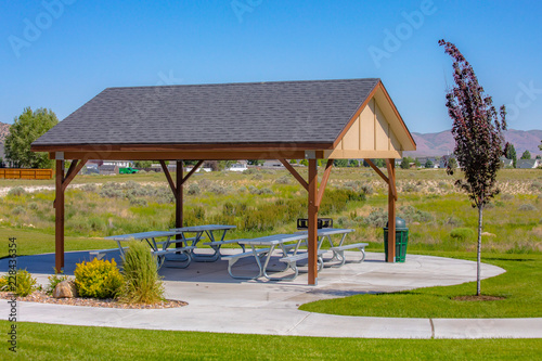 Wallpaper Mural Gazebo with picnic table bench on a sunny park