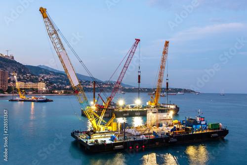 Fotografija Crane vessels on water at sunset
