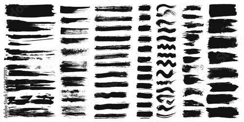 Obraz na plátne Set of different ink paint brush strokes isolated on white background