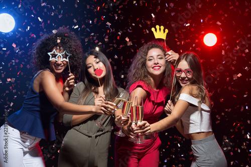 Happy women celebrating New Year at nightclub