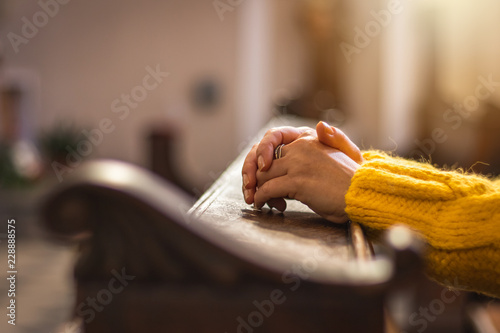 Female hands during prayer meditation in church