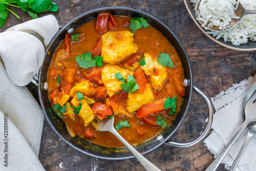 Fish Mappas - Kerala style coconut fish curry with rice. It's a popular dish in southern Indian state of Kerala. Top view