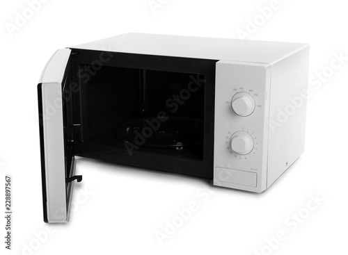Open modern microwave oven on white background. Kitchen appliance