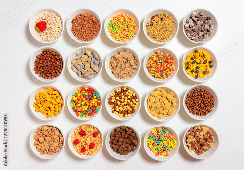 Photo set of different cereals on a white background