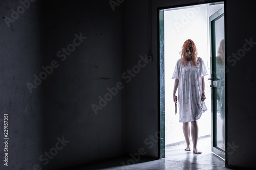 Canvas Print Scary ghost woman in nightgown with knife / halloween, zombie concept