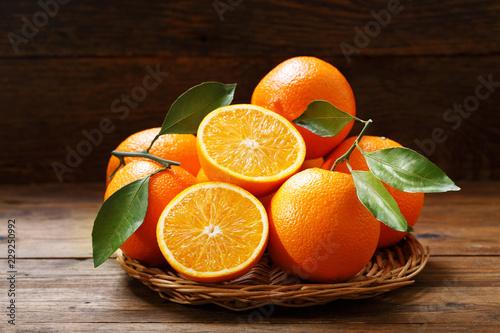 fresh orange fruits on wooden table
