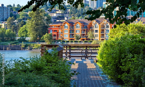 Obraz na płótnie Apartment Buildings and promenade quay at the waterfront of New Westminster Down