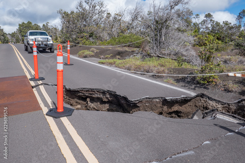 Fotografie, Obraz Cracks and damages on the road, following earthquakes caused by eruption of Kīla