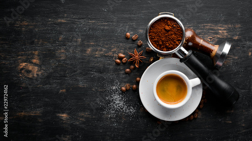 Fotografia Espresso coffee On a wooden background