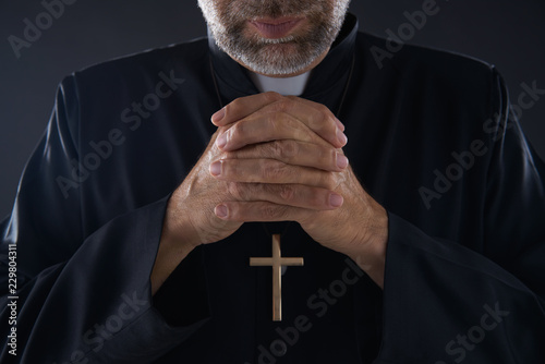 Obraz na płótnie Praying hands priest portrait of male pastor
