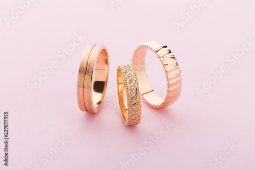 Stylish pink gold rings with different design on pink background