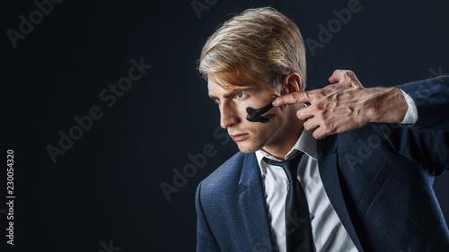 Fotografie, Obraz Businessman with war paint on his face. Risk management concept.