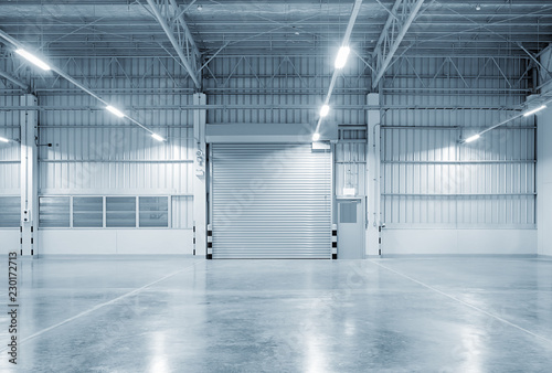 Obraz na płótnie Roller door or roller shutter inside factory, warehouse or industrial building