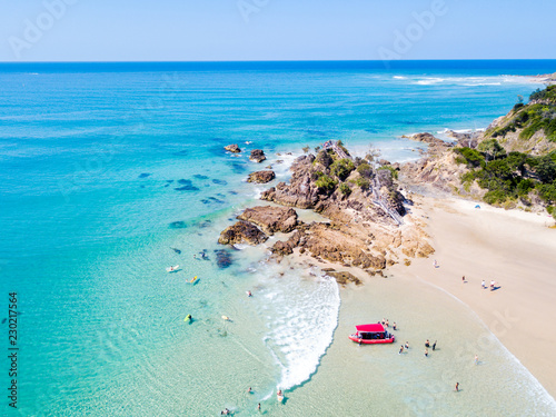 The Pass and Wategoes at Byron Bay from an aerial view with blue water Fototapeta
