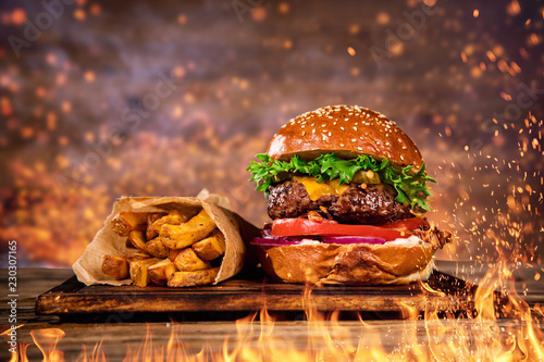Wallpaper Mural Tasty burger with french fries and fire.