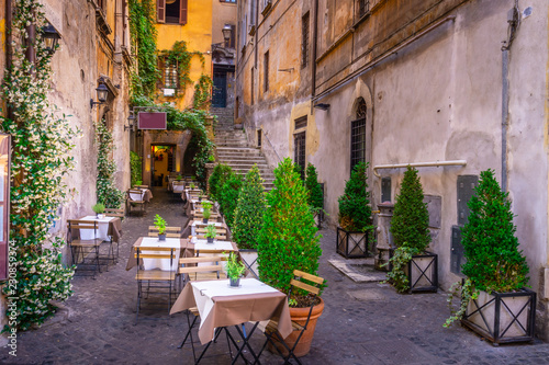 Cozy street in downtown, Rome, Europe. Touristic attraction of Rome.