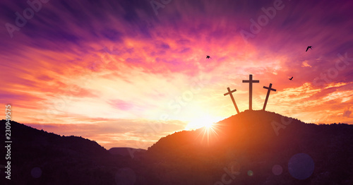 Christmas concept: Crucifixion Of Jesus Christ Cross At Sunset Fototapete