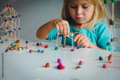 child making geometric shapes, engineering and STEM