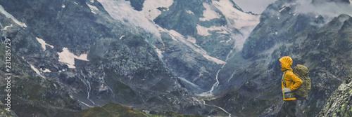 Obraz na plátně Mountain hike Europe travel hiker woman trekking in Switzerland Alps mountains landscape background