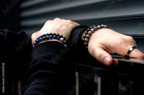Fotografía Men's bracelets on hand
