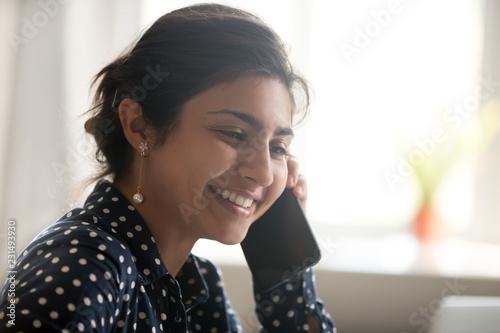 Smiling beautiful millennial indian woman talking on the phone, happy young girl Tapéta, Fotótapéta