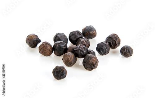 Stampa su Tela black pepper corns on white background